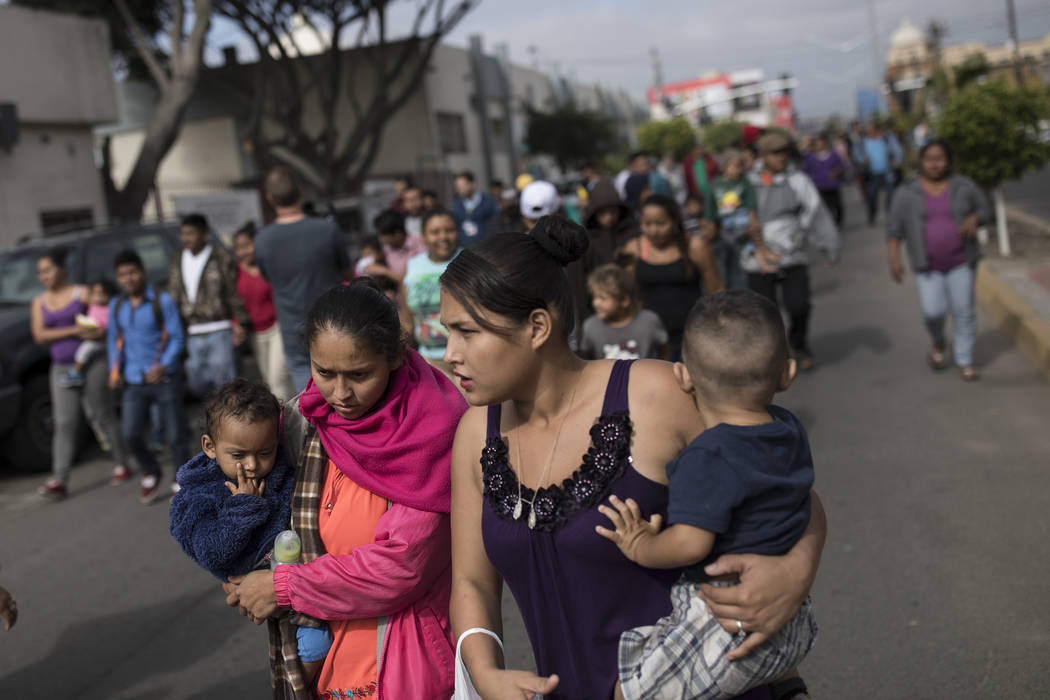 Migrants walk to the place where they will be meeting with lawyers, seeking to enter the United States from Tijuana, Mexico, Friday, April 27th 2018. (AP Photo/Hans-Maximo Musielik)