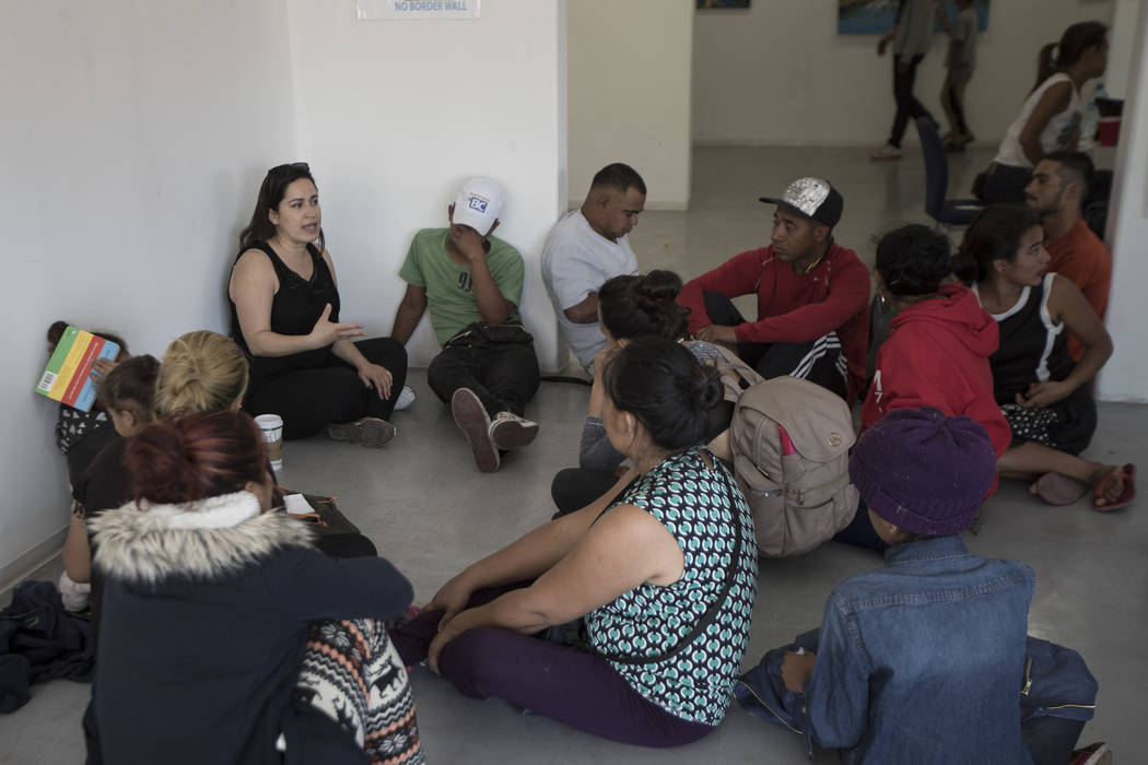 A US volunteer lawyer informs migrants on what to expect when requesting asylum in the US, at an office in Tijuana, Mexico, Friday, April 27, 2018. Close to 200 migrants from Central America, most ...