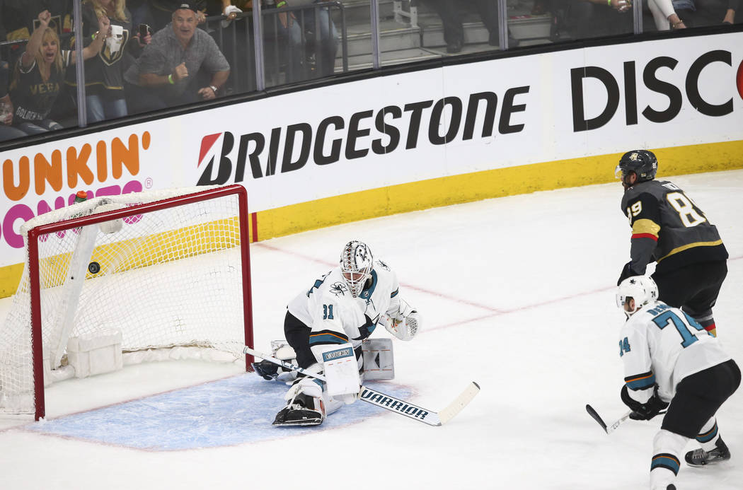 Golden Knights right wing Alex Tuch (89) scores a goal past San Jose Sharks goaltender Martin Jones (31) during the first period of Game 1 of an NHL hockey second-round playoff series at T-Mobile ...