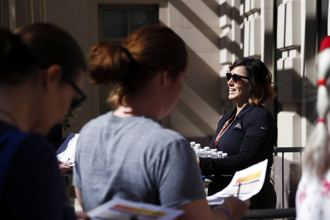 """Carmel Dunn, a graphic artist, hands out water to folks in line for """"Hamilton"""" tickets at The Smith Center in Las Vegas on Saturday, April 28, 2018. Andrea Cornejo Las Vegas Review-Journ ..."""