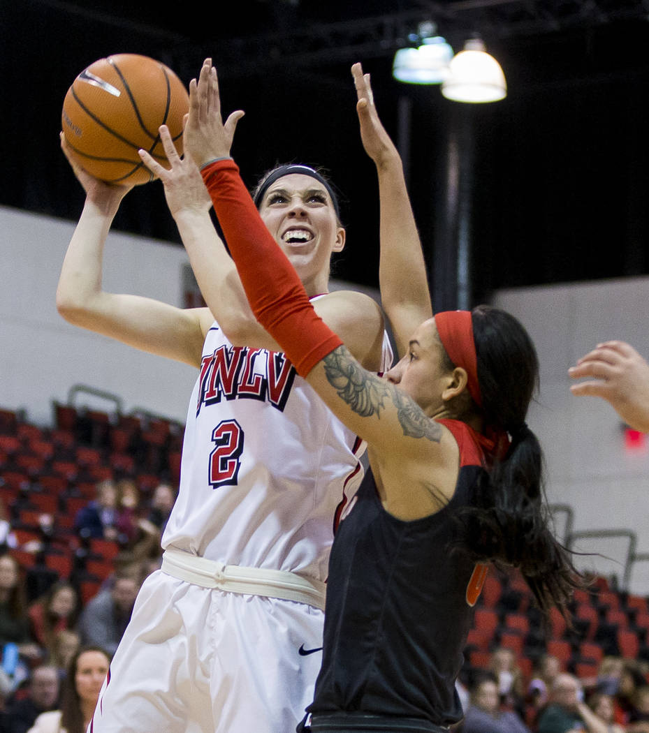UNLV Rebels guard Brooke Johnson (2) goes up for a shot while being guarded by New Mexico Lobos guard Cherise Beynon (0) at Cox Pavilion in Las Vegas on Saturday, Feb. 24, 2018. UNLV won 74-62. P ...