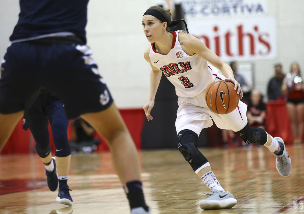 UNLV Lady Rebels guard Brooke Johnson (2) drives against the Utah State Aggies during the first half of a basketball game at the Cox Pavilion in Las Vegas on Friday, March 2, 2018. Chase Stevens L ...