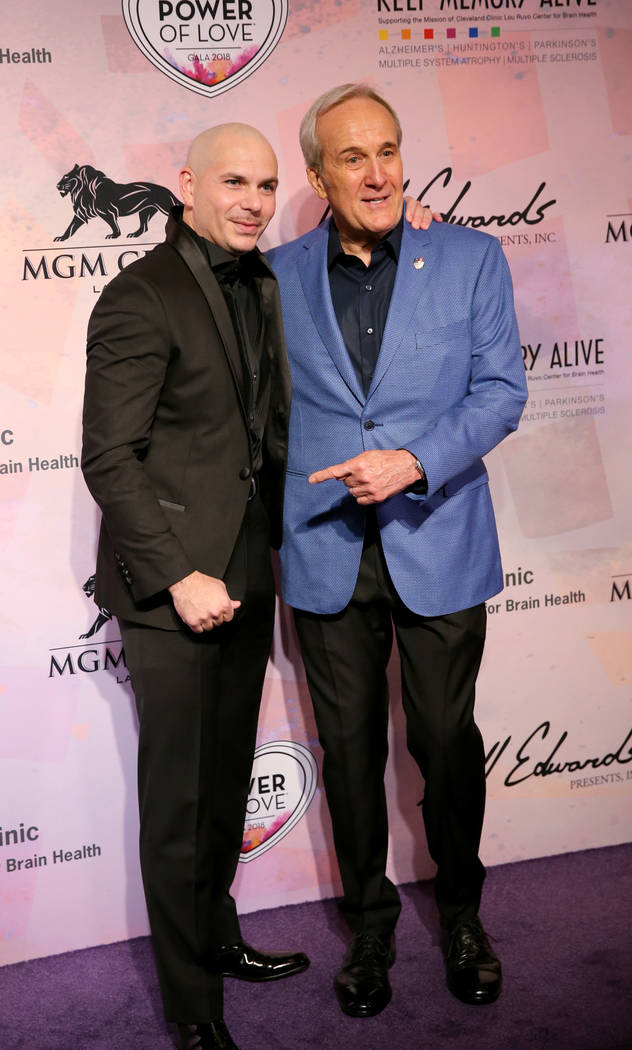 Planet Hollywood resident headliner Pitbull, left, and Larry Ruvo on the purple carpet at the 22nd annual Power of Love gala in the MGM Grand Garden Arena in Las Vegas Saturday, April 28, 2018. Th ...