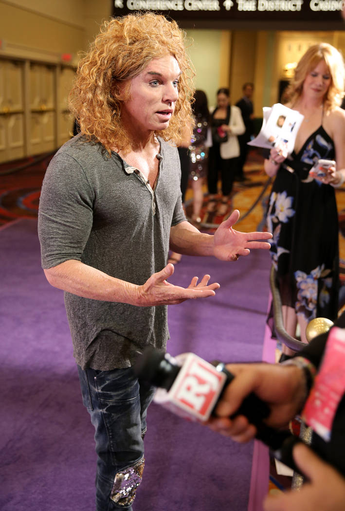 Luxor resident comedian Carrot Top talks to Las Vegas Review-Journal columnist John Katsilometes on the purple carpet at the 22nd annual Power of Love gala in the MGM Grand Garden Arena in Las Veg ...