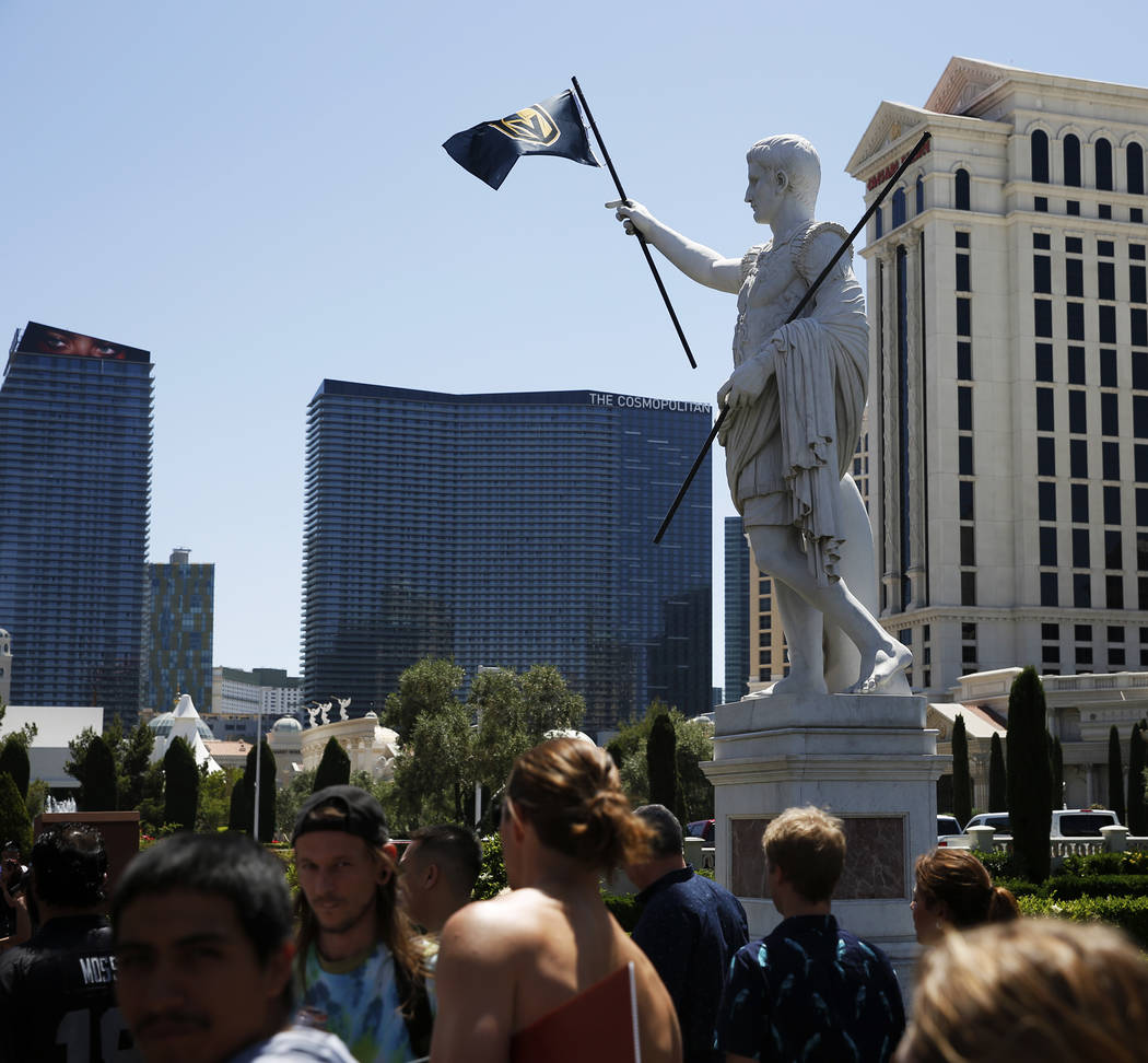 A view of a statue holding a Vegas Golden Knights flag at Caesars Palace in Las Vegas on Saturday, April 28, 2018. Andrea Cornejo Las Vegas Review-Journal @dreacornejo