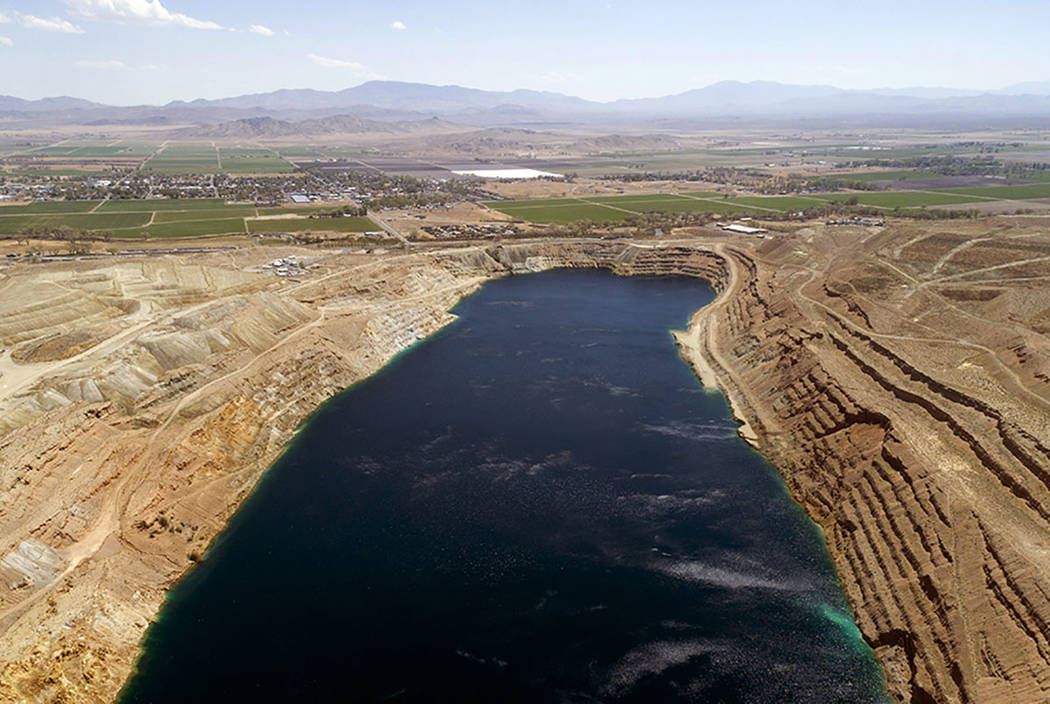 The abandoned Anaconda open pit mine, source of an underground plume of poisonous water, is seen in an aerial photo in Yerington on Friday. (AP Photo/Scott Sady)