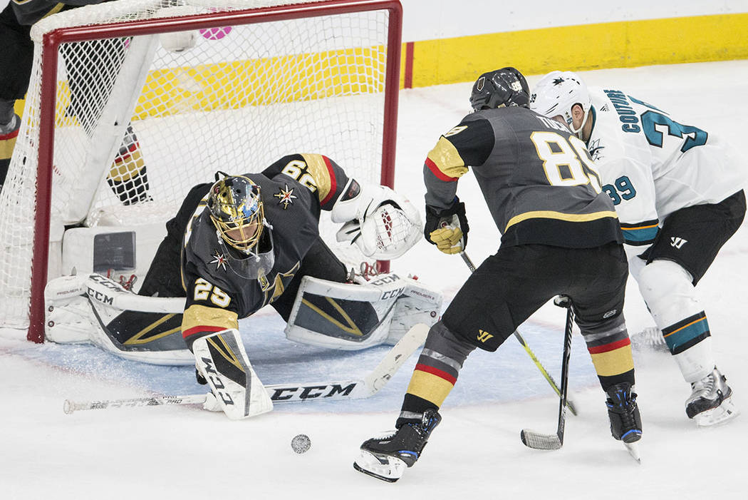 Golden Knights goaltender Marc-Andre Fleury (29) makes a save against San Jose Sharks center Logan Couture (39) with the help of right wing Alex Tuch (89) during game two of their second round pl ...