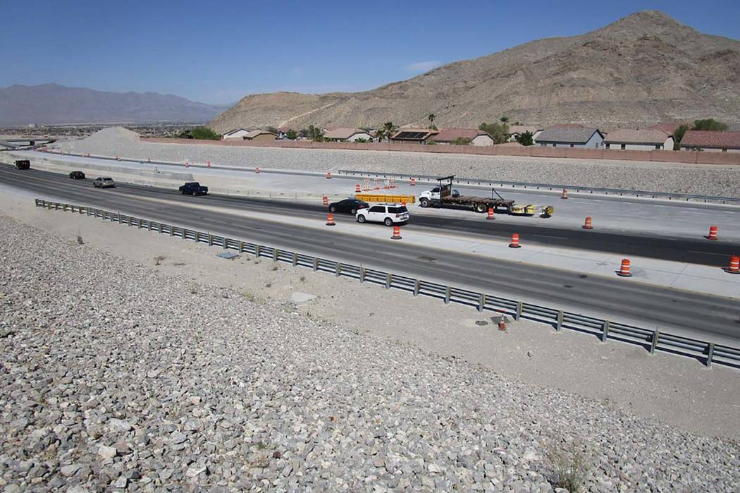 Traffic follows lane closures around barriers on the 215 Beltway just south of Lone Mountain Road on Saturday, April 28, 2018. Travel lanes will be opened to northbound traffic this week. (Greg Ha ...