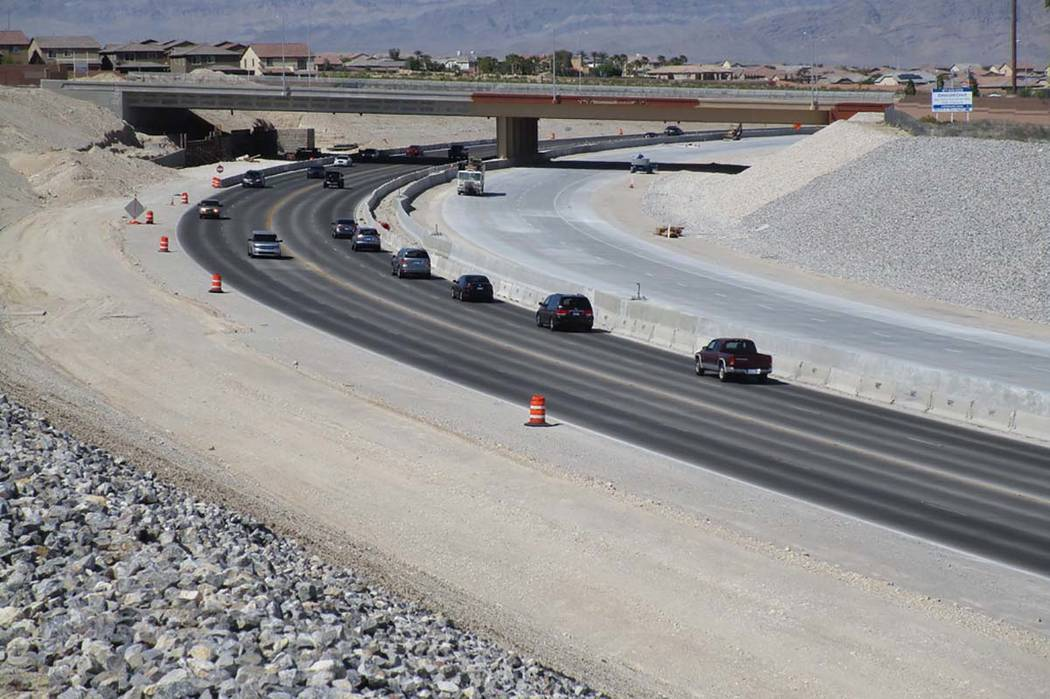 Traffic shares the lanes that will be dedicated to southbound traffic near the Centennial Parkway overpass on the 215 Beltway on Saturday, April 28, 2018. Travel lanes will be opened to northbound ...