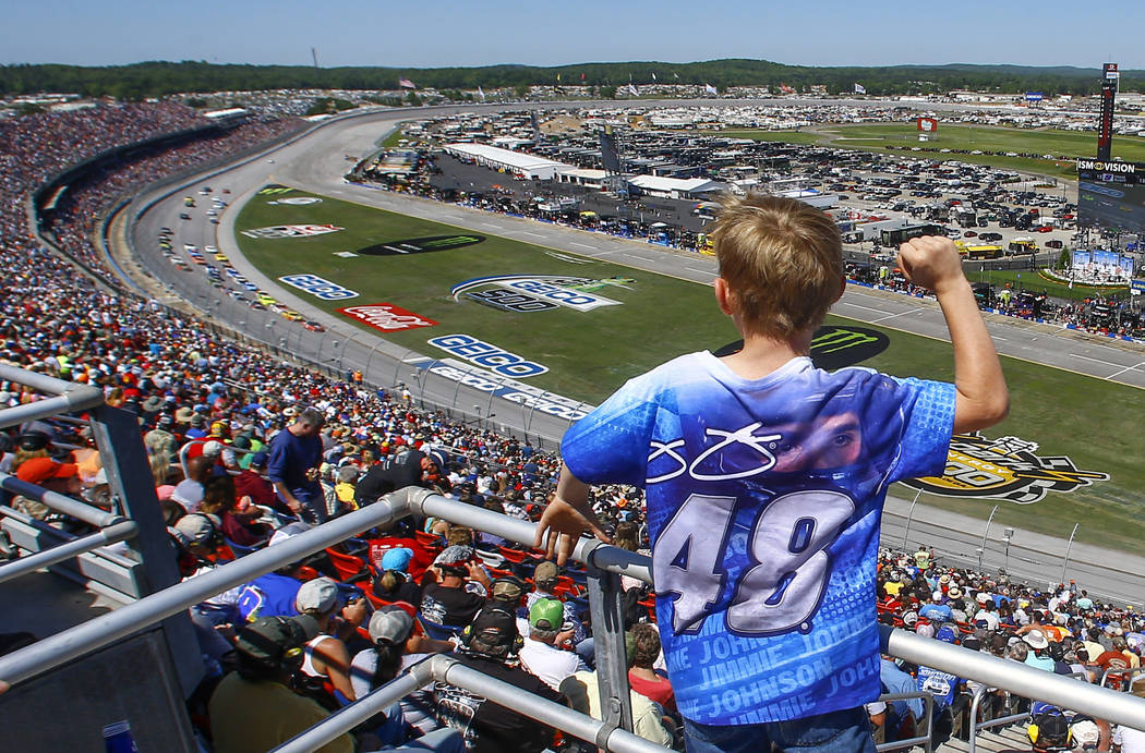 A young fan cheers as racers go by during a NASCAR Talladega auto race at Talladega Superspeedway, Sunday, April 29, 2018, in Talladega, Ala. (AP Photo/Butch Dill)