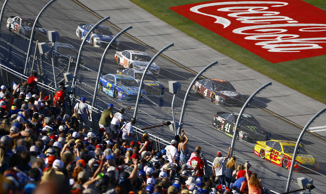 Joey Logano (22) leads the pack to the finish line during the NASCAR Talladega auto race at Talladega Superspeedway, Sunday, April 29, 2018, in Talladega, Ala. (AP Photo/Butch Dill)