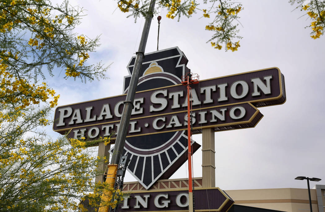 Workers prepare to remove the last piece of Palace Station's iconic train theme, first unveiled in 1983, on Monday, April 30, 2018, in Las Vegas. The first piece of the marquee, an 11-foot- ...