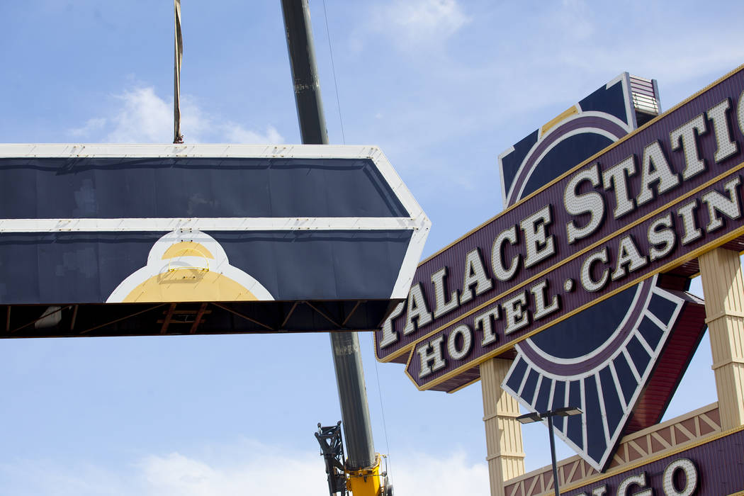 The top piece of Palace StationÕs train sign is dismantled in Las Vegas, Monday, April 30, 2018. The marquee is the final train-themed remnant of the Station Casinos' first property. The hote ...