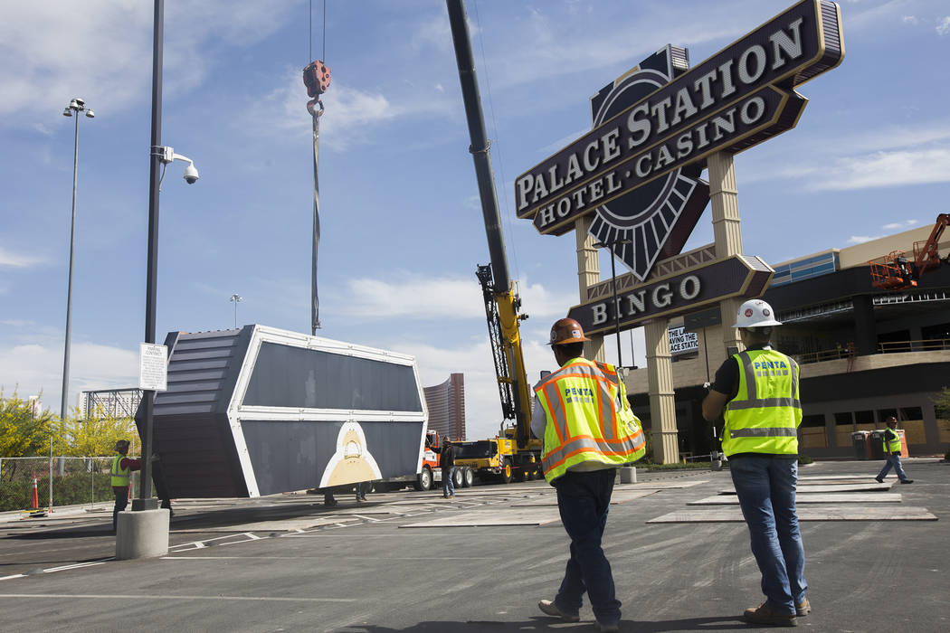 The top piece of Palace Station's train sign is dismantled in Las Vegas, Monday, April 30, 2018. The marquee is the final train-themed remnant of the Station Casinos' first property. The ho ...