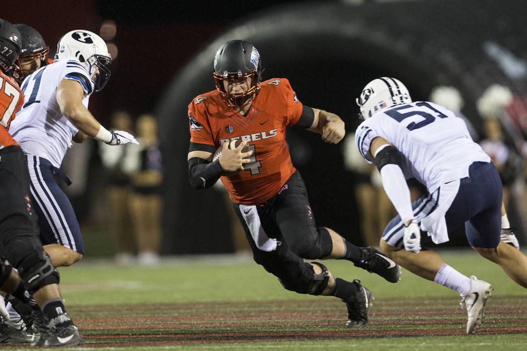 UNLV Rebels quarterback Johnny Stanton (4) runs the ball against Brigham Young Cougars in the football game at Sam Boyd Stadium in Las Vegas, Friday, Nov. 10, 2017. Erik Verduzco Las Vegas Review- ...