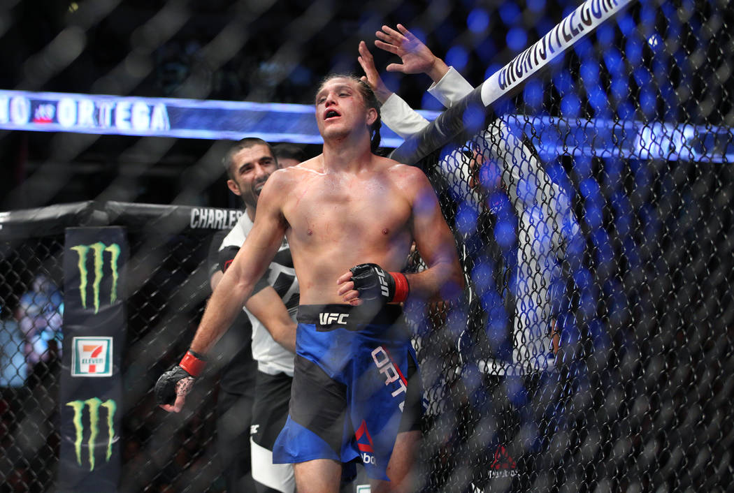 Brian Ortega celebrates after defeating Renato Moicano in the featherweight bout during UFC 214 at the Honda Center in Anaheim, Calif., on Saturday, July 29, 2017. Ortega won by way of submission. ...