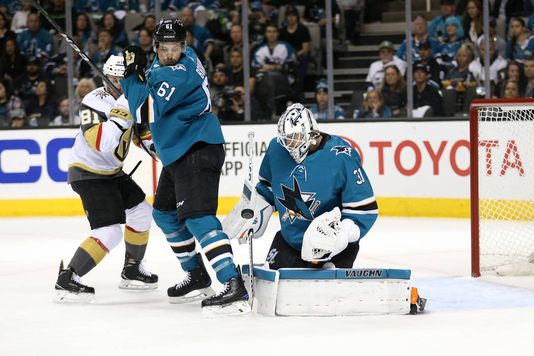 San Jose Sharks goaltender Martin Jones (31) looks at the puck before making a stop during the first period against the Vegas Golden Knights in Game 3 of an NHL hockey second-round playoff series ...