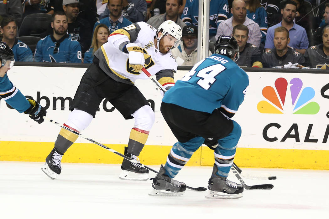 Vegas Golden Knights left wing James Neal (18) takes a shot under pressure from San Jose Sharks defenseman Marc-Edouard Vlasic (44) during the first period in Game 3 of an NHL hockey second-round ...