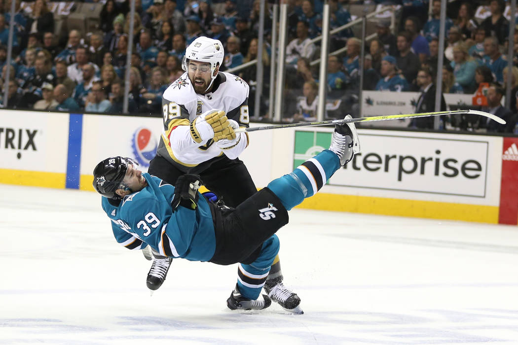 Vegas Golden Knights right wing Alex Tuch (89) knock down San Jose Sharks center Logan Couture (39) during the first period in Game 3 of an NHL hockey second-round playoff series at the SAP Center ...