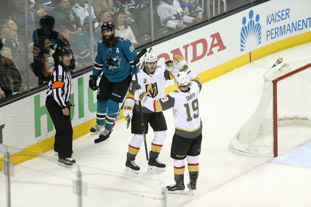 Vegas Golden Knights right wing Reilly Smith (19) celebrates after a score against the San Jose Sharks with an assist of center William Karlsson (71) during the second period in Game 3 of an NHL h ...