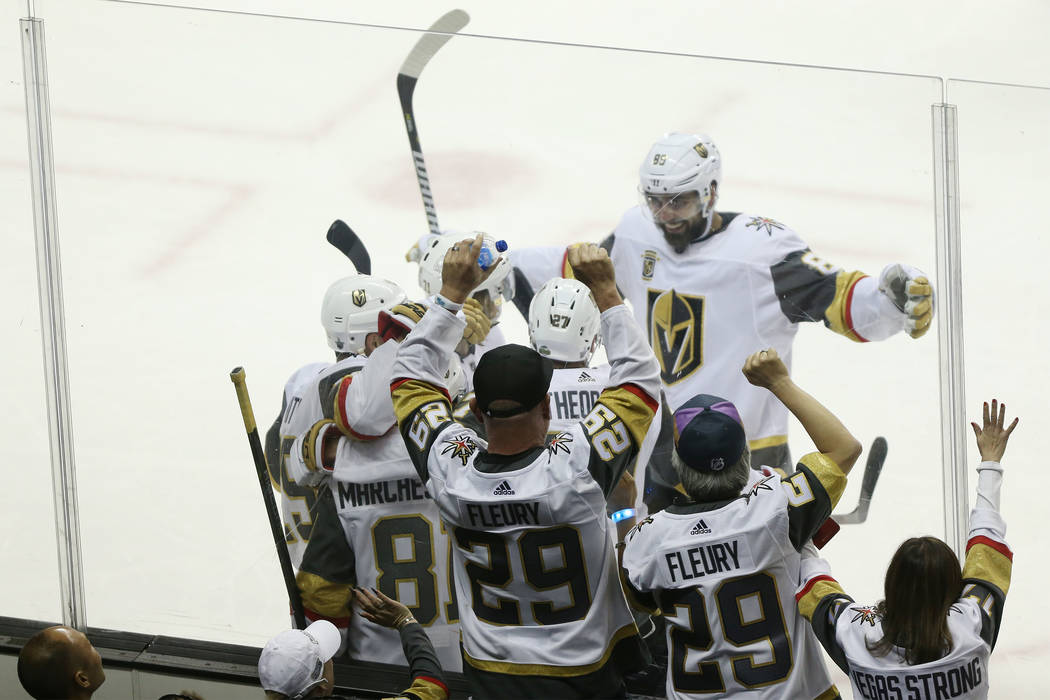 Fans watch the Vegas Golden Knights celebrate a score by center Jonathan Marchessault (81) during the second period in Game 3 of an NHL hockey second-round playoff series at the SAP Center in San ...