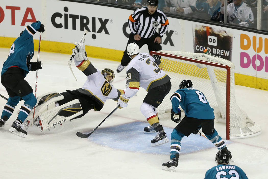 Vegas Golden Knights goaltender Marc-Andre Fleury (29) dives for the puck as defenseman Brayden McNabb (3) look on during the second period in Game 3 of an NHL hockey second-round playoff series a ...