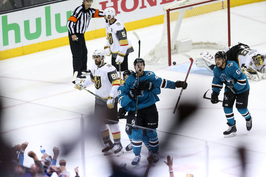 San Jose Sharks center Tomas Hertl (48) celebrates his score as he is hugged by right wing Timo Meier (28) during the third period in Game 3 of an NHL hockey second-round playoff series at the SAP ...