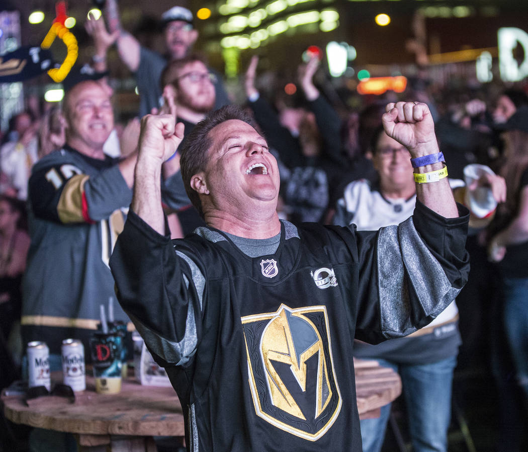 Golden Knights fan Rob Lawrence celebrates after a second period goal at a watch party during game three of Vegas' playoff series with the San Jose Sharks on Monday, April 30, 2018, at Downtown La ...