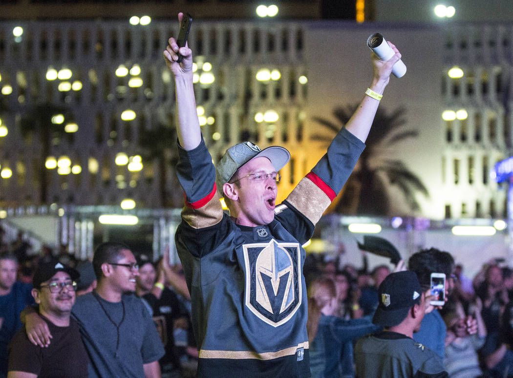 Golden Knights fan Anthony Soleau cheers after a second period goal at a watch party during game three of Vegas' playoff series with the San Jose Sharks on Monday, April 30, 2018, at Downtown Las ...