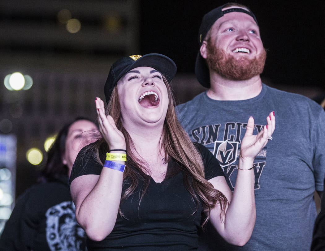 Golden Knights fan Kelly Lange, left, celebrates after a second period goal at a watch party during game three of Vegas' playoff series with the San Jose Sharks on Monday, April 30, 2018, at Downt ...