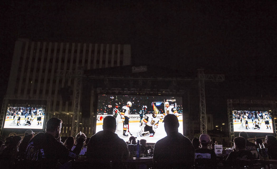 Golden Knights fans fill the Downtown Las Vegas Events Center for a watch party during game three of Vegas' playoff series with the San Jose Sharks on Monday, April 30, 2018, in Las Vegas. Benjami ...