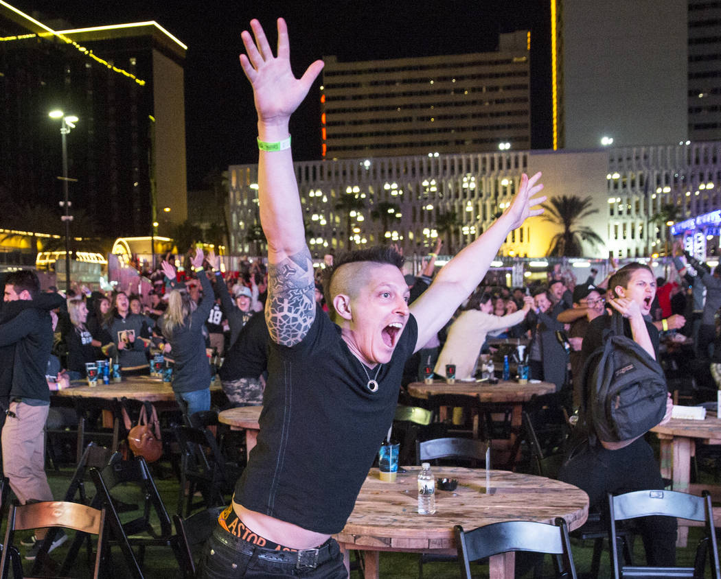 Golden Knights fan Billy Kesner, middle, celebrates at a watch party after Vegas' Jonathan Marchessault scored an overtime goal to beat the San Jose Sharks 4-3 during game three of Vegas' playoff ...