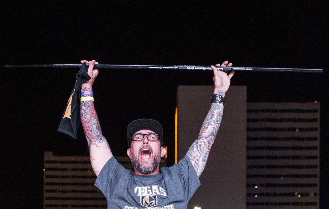 Golden Knights fan Jameson Jackson celebrates at a watch party after Vegas' Jonathan Marchessault scored an overtime goal to beat the San Jose Sharks 4-3 during game three of Vegas' playoff series ...