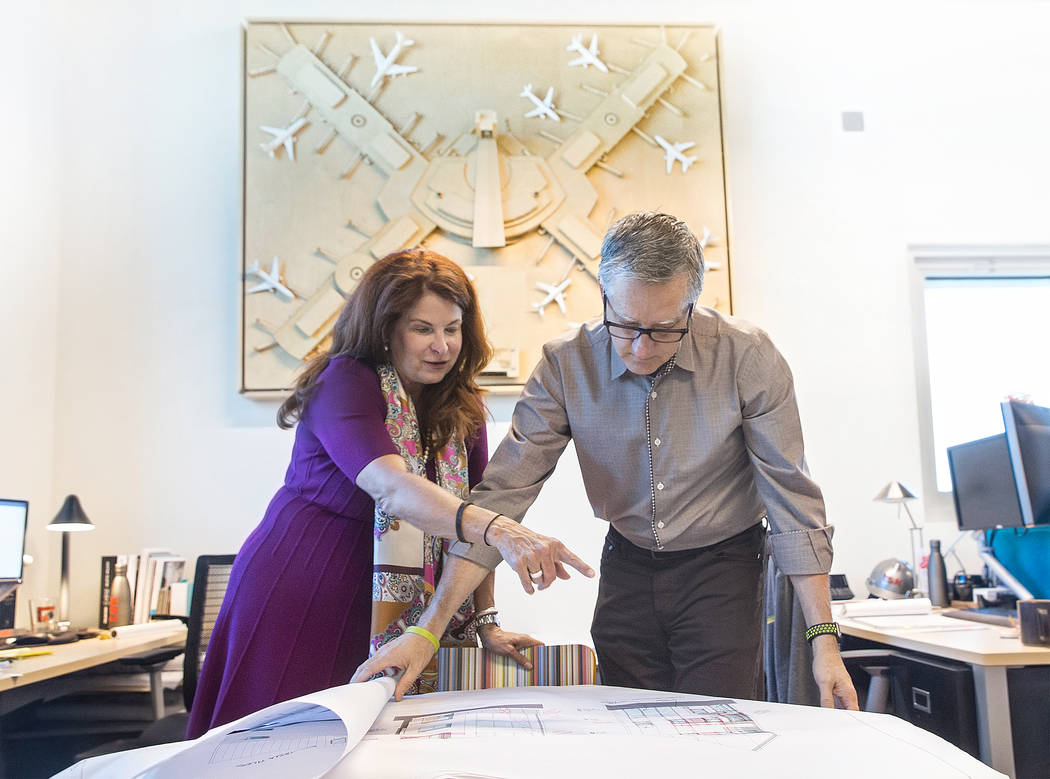 Henderson Mayor Debra March, left, and TSK president Windom Kimsey look over plans for a new commercial/residential office space for Kimsey's architecture firm on Monday, Aug 14, 2017, at TSK, in  ...