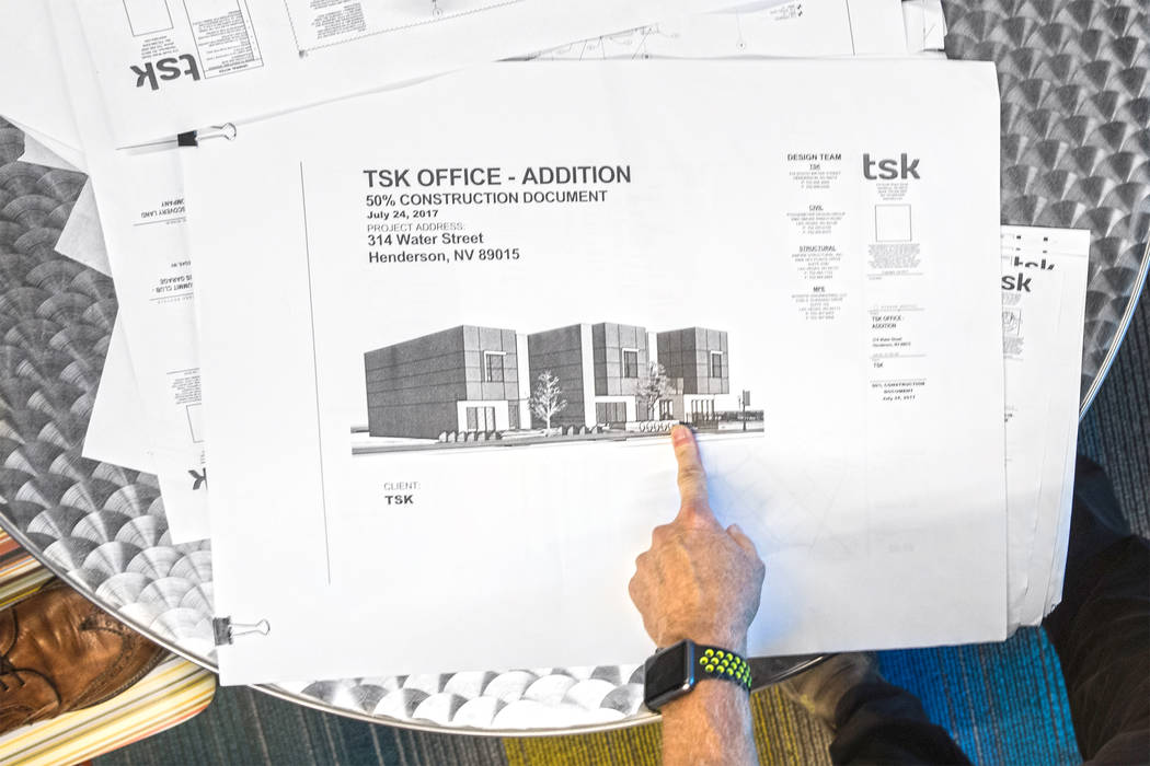 TSK president Windom Kimsey points out features of a new commercial/residential office space for Kimsey's architecture firm with Henderson Mayor Debra March on Monday, Aug 14, 2017, at TSK offices ...