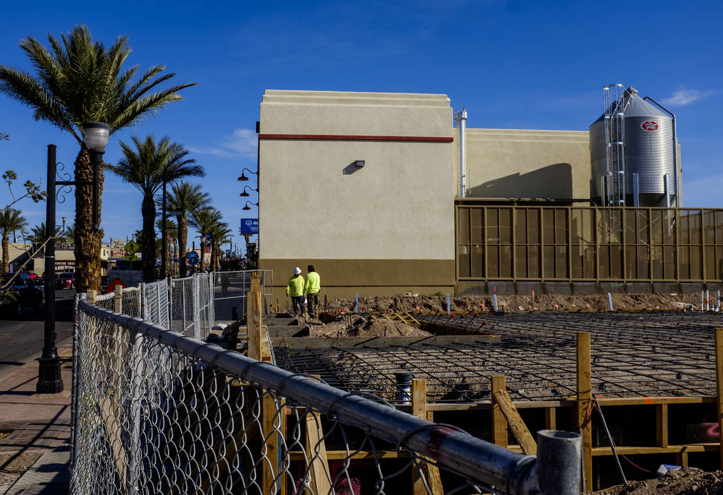 Construction workers at construction site for Juan's Flaming Fajitas and Cantina with Lovelady Brewing Co. in the background on Water Street in Henderson on Friday, March 30, 2018.  Patrick Connol ...
