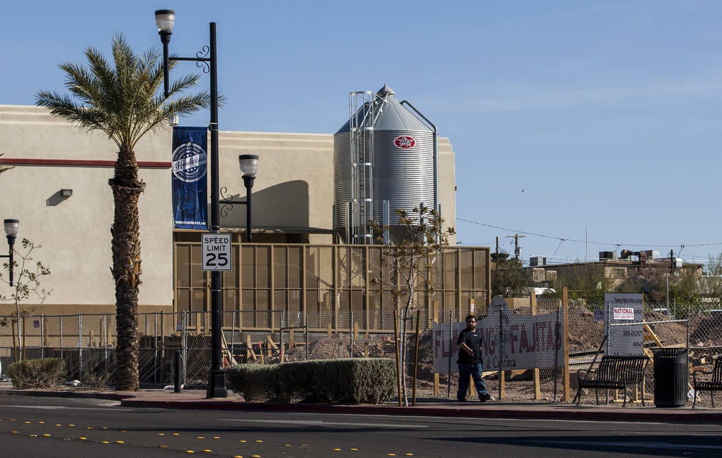 A man walks past the construction site for Juan's Flaming Fajitas and Cantina and Lovelady Brewing Co. on Water Street in Henderson on Friday, March 30, 2018.  Patrick Connolly Las Vegas Review-Jo ...