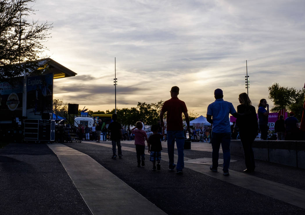 People walk onto the event plaza on Water Street in Henderson for a Last Friday event on Friday, March 30, 2018.  Patrick Connolly Las Vegas Review-Journal @PConnPie