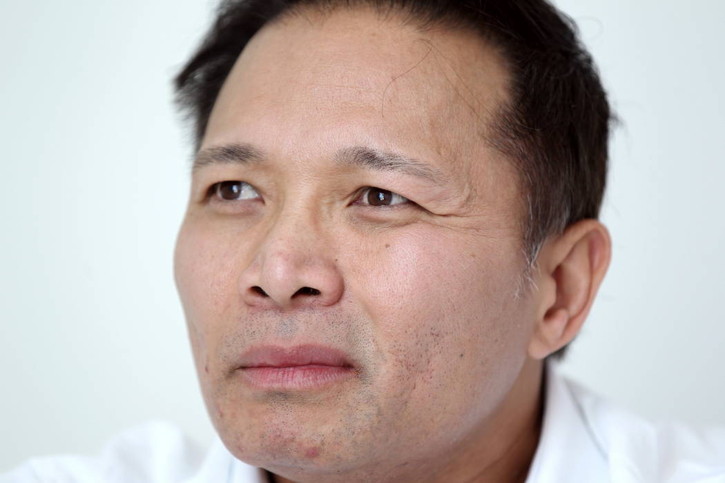 Real estate investor Andy Pham talks to a reporter at his Las Vegas office Jan. 29, 2018. Pham and his investors lost control of a multi-million dollar Las Vegas property to fraudsters who filed f ...