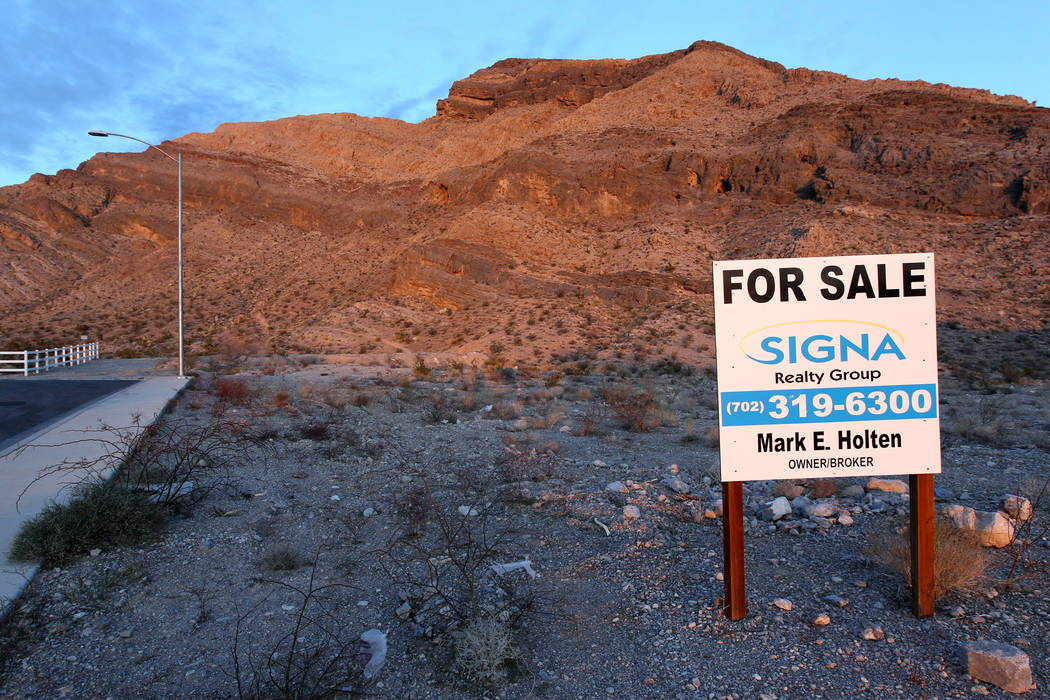"A fraudulent ""for sale"" sign on a northwest Las Vegas property owned by real estate investor Andy Pham and his investors Jan. 30, 2018. Pham and his investors lost control of the multi-m ..."