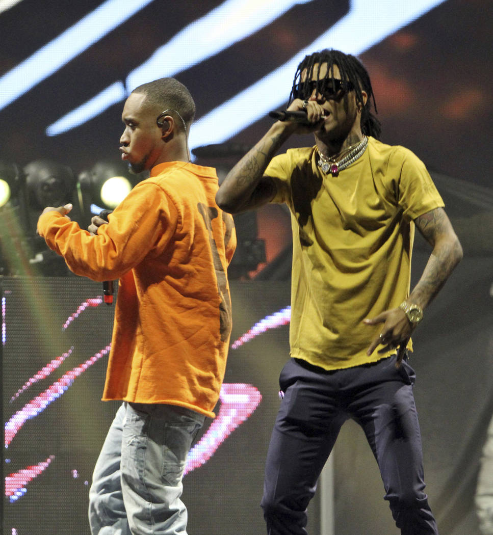 Slim Jxmmi and Swae Lee with Rae Sremmurd performs as the opener for The Weeknd at Philips Arena on Saturday, May 13, 2017, in Atlanta. (Photo by Robb Cohen/Invision/AP)
