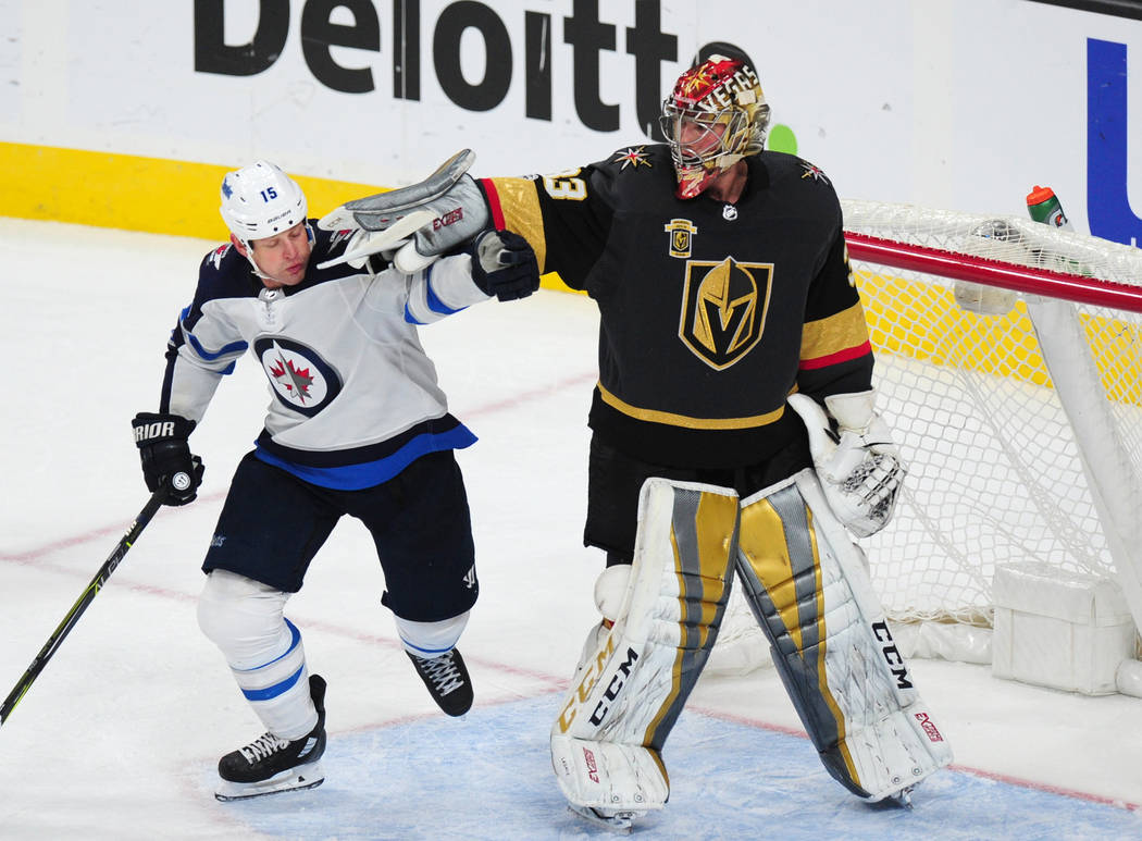 Vegas Golden Knights goalie Maxime Lagace interferes with Winnipeg Jets forward Matt Hendricks (15) in the third period of their NHL hockey game at T-Mobile Arena in Las Vegas Friday November 10, ...
