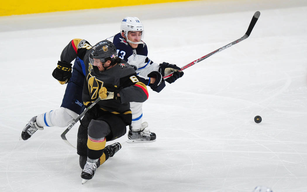 Vegas Golden Knights defenseman Colin Miller interferes with Winnipeg Jets forward Brandon Tanev during the third period of their NHL hockey game at T-Mobile Arena in Las Vegas Friday November 10, ...