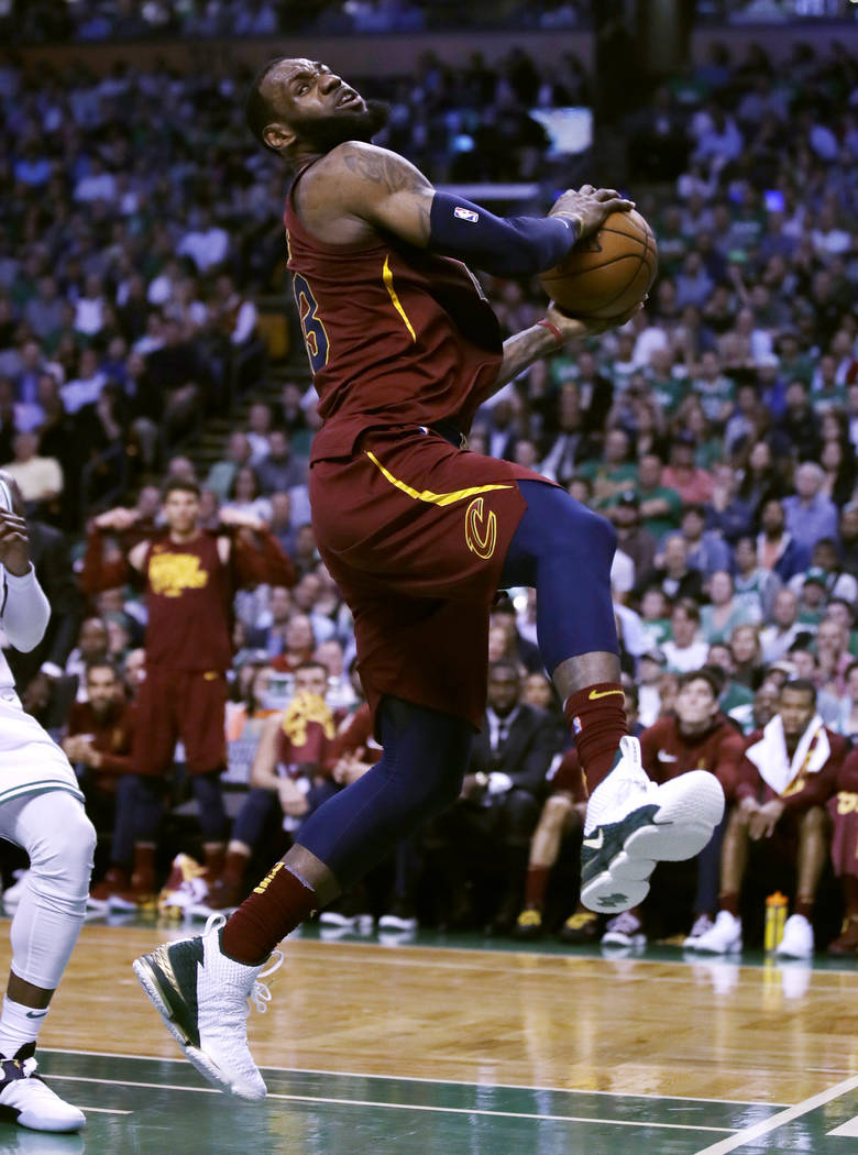 Cleveland Cavalier's LeBron James drives to the basket during Game 2 of the Eastern Conference basketball finals in Boston, Tuesday, May 15, 2018. (AP Photo/Charles Krupa)