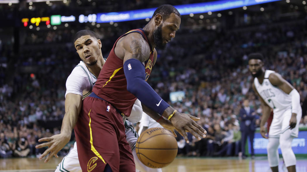 Cleveland Cavalier's LeBron James loses the ball as he is pressured by Boston Celtics Jayson Tatum during Game 2 of the Eastern Conference basketball finals in Boston, Tuesday, May 15, 2018. (AP P ...