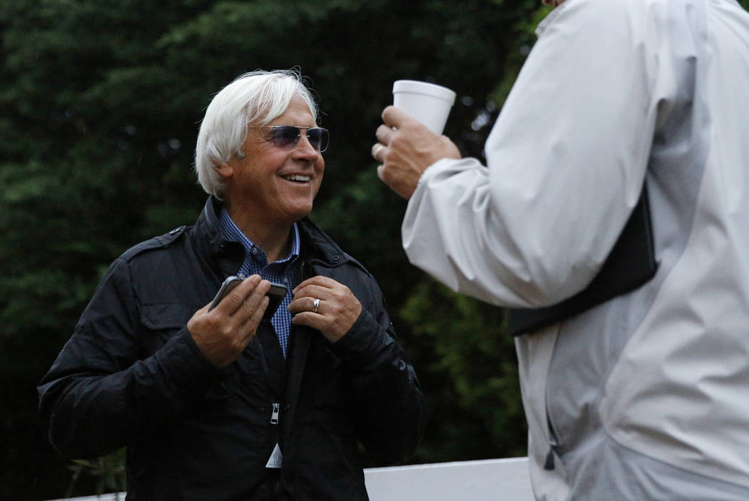 Bob Baffert, left, trainer of Kentucky Derby winner Justify, chats with Winstar Farm CEO Elliott Walden, Friday, May 18, 2018, at Pimlico Race Course in Baltimore. The Preakness Stakes horse race ...