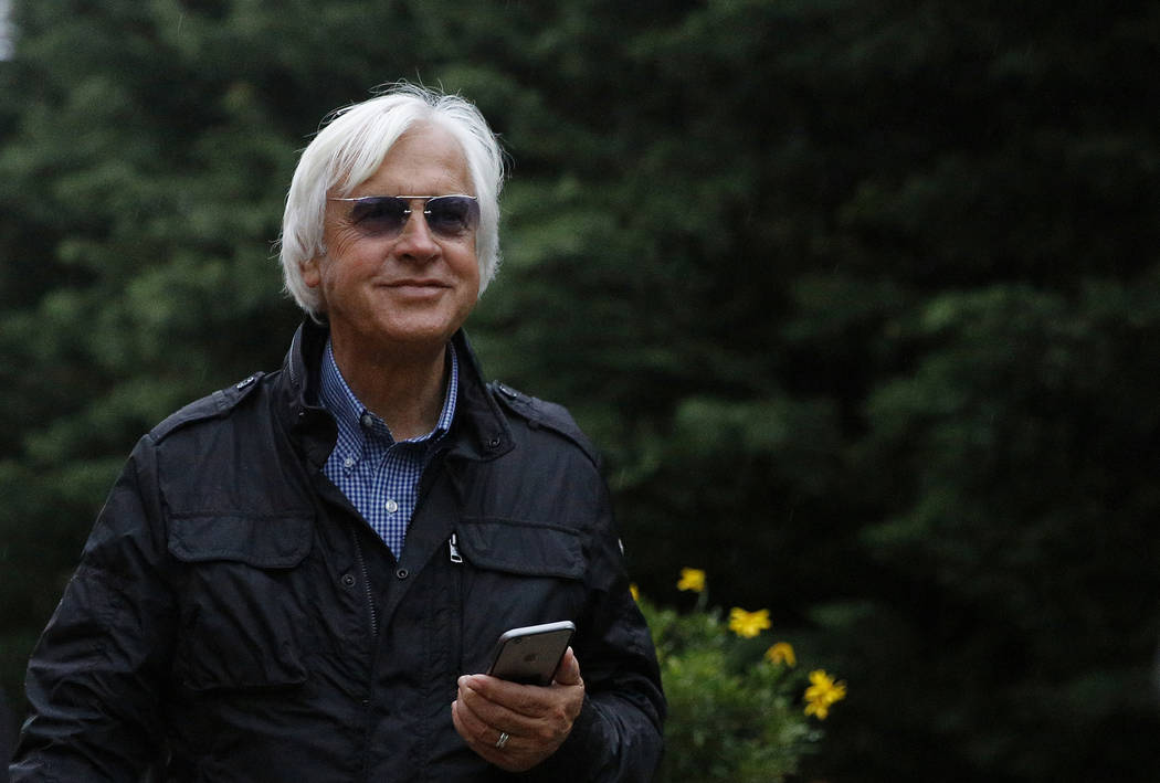 Bob Baffert, trainer of Kentucky Derby winner Justify, stands outside a barn, Friday, May 18, 2018, at Pimlico Race Course in Baltimore. The Preakness Stakes horse race is scheduled to take place ...