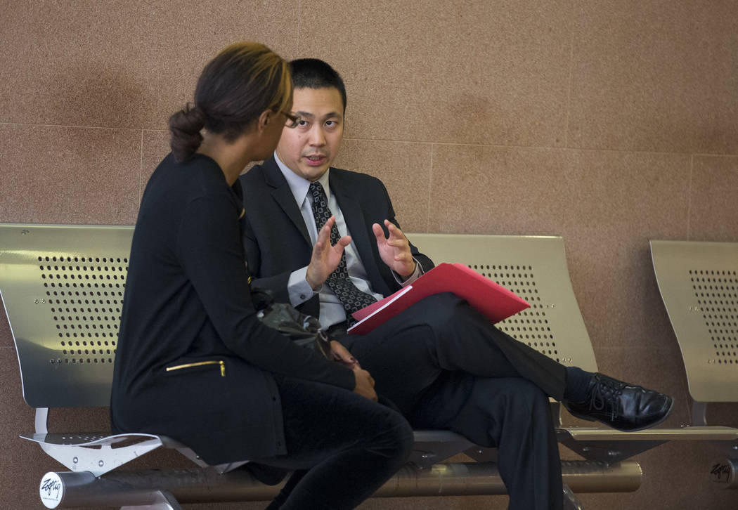 Nevada Legal Services attorney Ron Sung, right, speaks to a Housing Choice Voucher recipient before an eviction hearing in Las Vegas Justice Court on Friday, May 25, 2018. Richard Brian Las Vegas ...