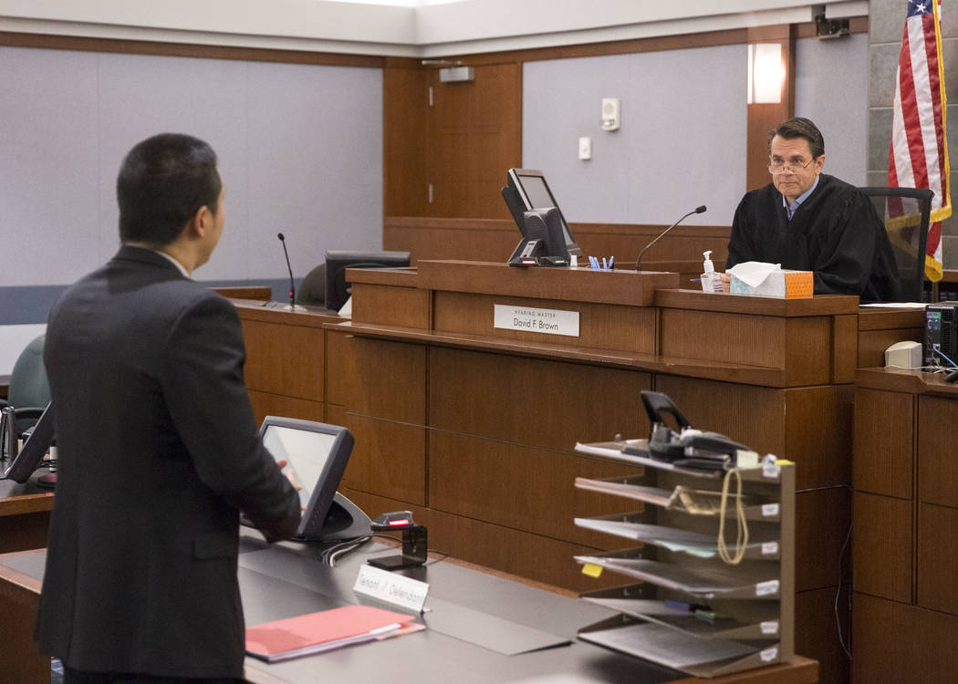 Nevada Legal Services attorney Ron Sung, left, during an eviction hearing for a Housing Choice Voucher recipient before Hearing Master David Brown in Las Vegas Justice Court on Friday, May 25, 201 ...