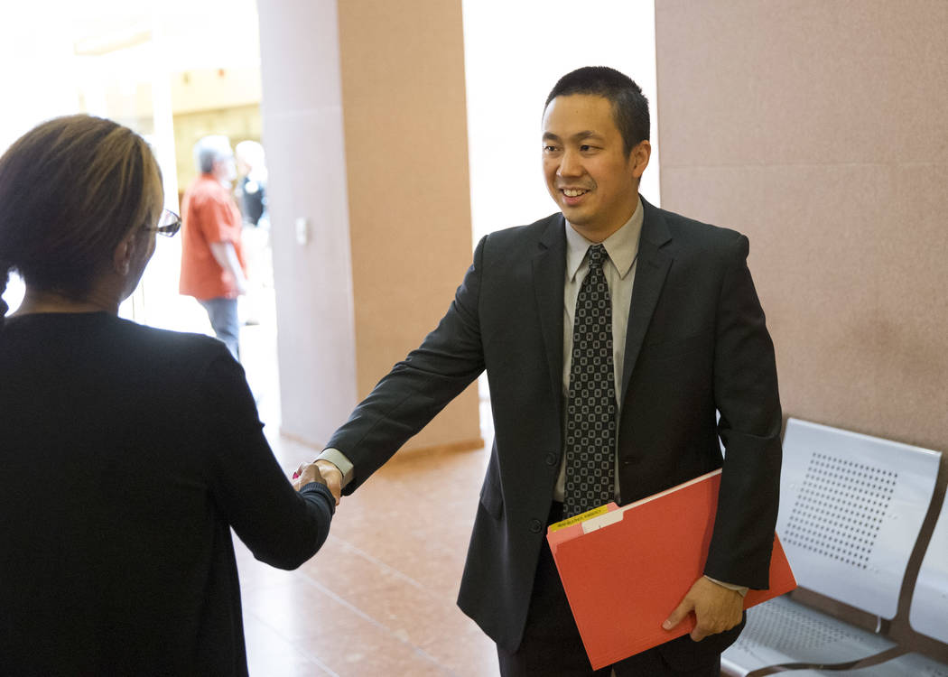 Nevada Legal Services attorney Ron Sung, right, shakes hands with a Housing Choice Voucher recipient following an eviction hearing in Las Vegas Justice Court on Friday, May 25, 2018. Sung helped t ...